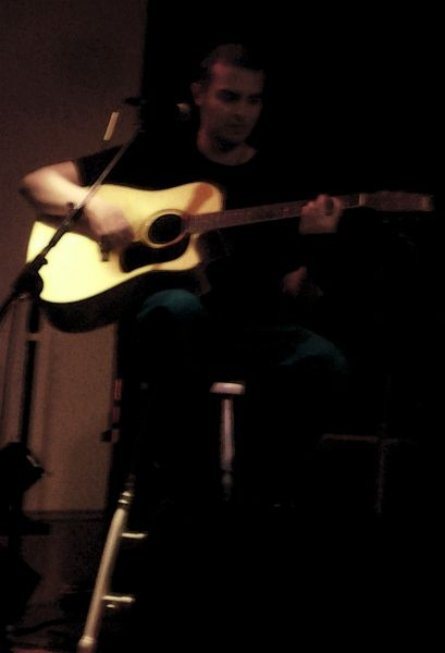 Live solo acoustic performance