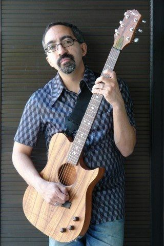 John Henry Soto with his Carvin Guitar