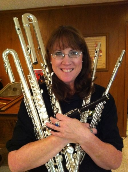I'm holding my custom made, sterling flute, a piccolo, an Eb flute, two alto flutes and a bass flute.  I love to arrange flute choir music.