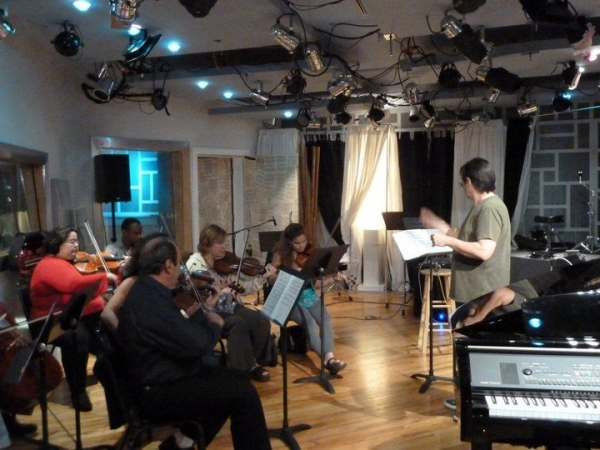 rehearsing my own arrangement of ' el manisero ' for a string octet. performance took place at the auditorium.