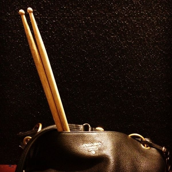 A Prada bag with drumsticks; girls can play drums, too!! :)