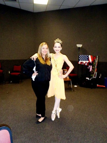 Me and one of my students at competition. She was competing a pointe solo.