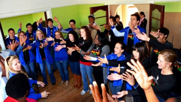 Just a taste of what music can bring you. This is a picture of my college choir singing and dancing for an orphanage in South Africa!