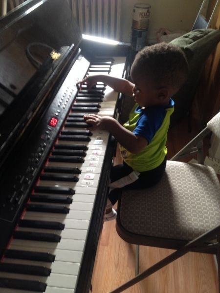 18 months old boy, learn to use his fingers on the keys.