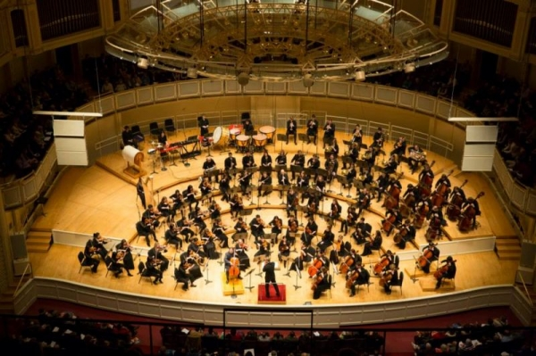 On stage at Orchestra Hall with the Civic Orchestra of Chicago and cellist Yo-Yo Ma.