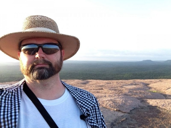 Enjoying the view on top of Enchanted Rock.