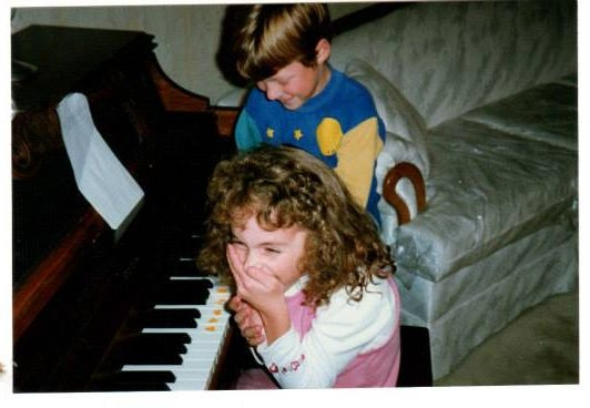 Me learning piano at the tender age of 6 years old :)