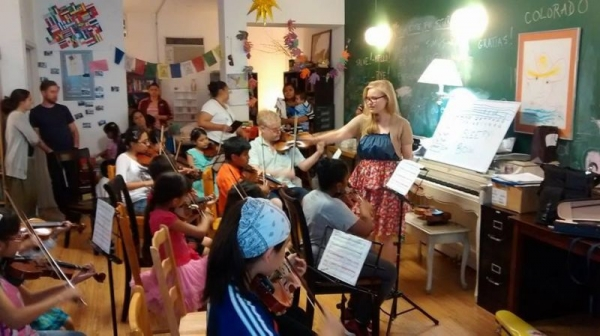 Conducting my student orchestra at Still Waters in a Storm in Bushwick Brookly,   www.stillwatersinastorm.org