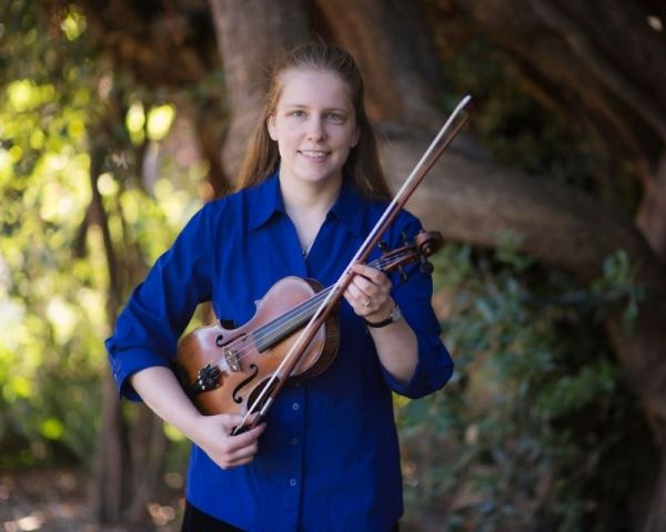 Holding my violin in the Botanical Gardens of San Francisco.