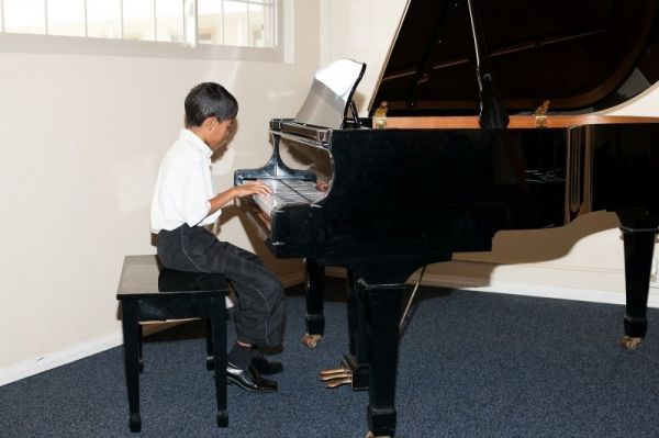 Student performing in Recital