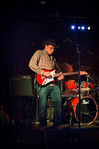 Joel Jackson performing with Moonfry; playing a Line 6 JTV-69 modeling Variax guitar through a Mesa Boogie Rocket44 combo.