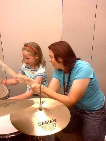Teaching a rock beat at Girls Rock n Roll Retreat in Minneapolis, MN - July 2008