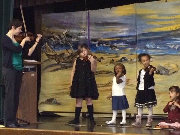Here are some of my students performing at a holiday bazaar. They have been playing for just 3 months!