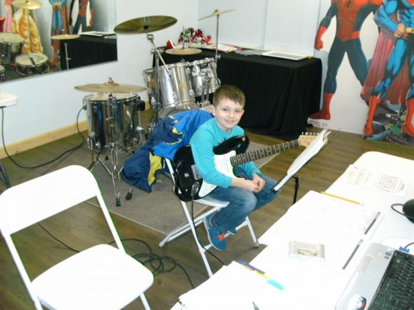 8 year old Anthony is learning songs by Ozzie, Metallica, and The Ramones. He's doing great!