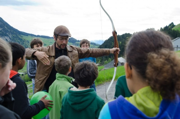 Gabriel teaching his 4th graders about basic archery.
