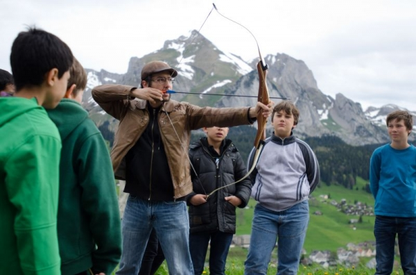Gabriel teaching basic archery to his 4th graders in Wildhaus, Switzerland.