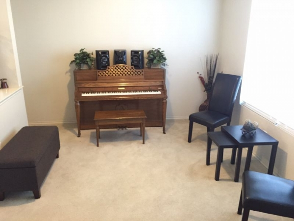 Home Lesson Studio with piano and sitting area.