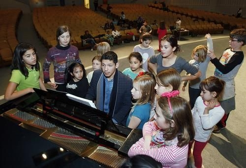 "Me rehearsing the orphans for the musical ""Annie."""