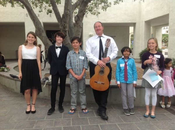 Jesse with some of his guitar students after the winter 2015 California Music Studios Recital at the Ruby G. Shulman Auditorium in Carlsbad.