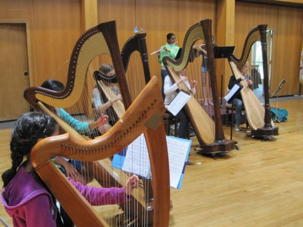 At my Elyrica Summer Music Program: 5 harpists playing with 2 flutists!