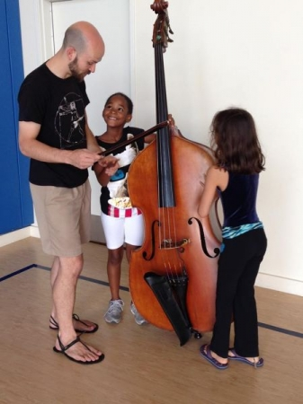 Showing some kids at the Opus One Music Camp how to play da bass!