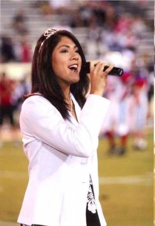"Singing ""God Bless America"" at the All Star Football game in San Jose."