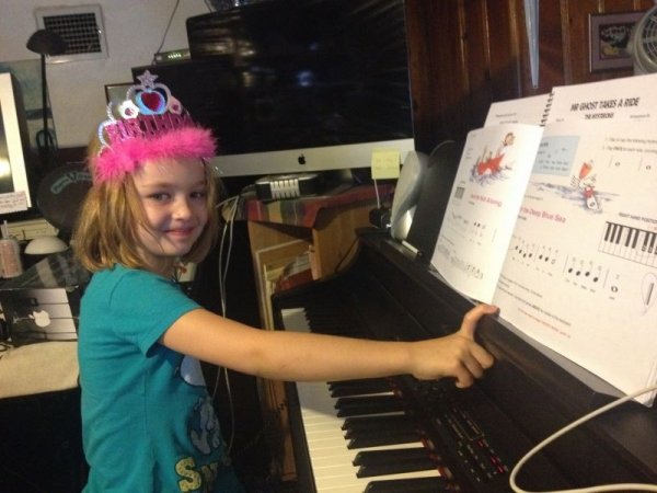 Even though it was her birthday, turning 7, she wanted to do her piano lesson! :)