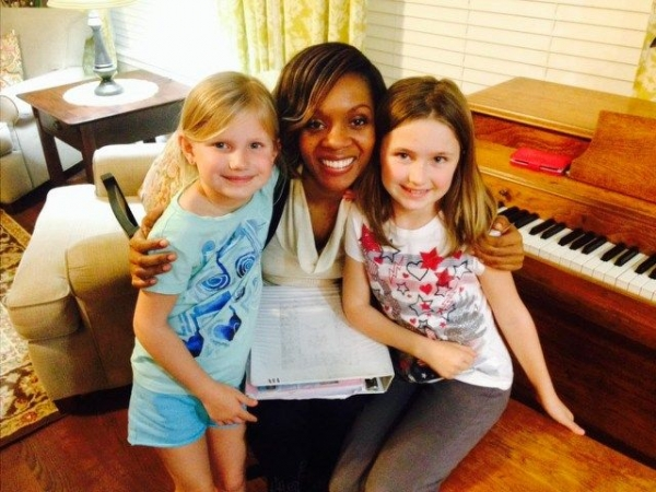 Sisters learning piano together!