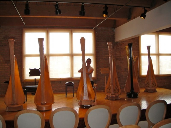 Trying out harps in Chicago at the Lyon and Healy Factory