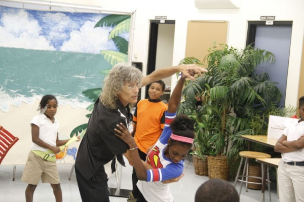 """Me demonstrating a """"corte,"""" a move used in the Tango.  I was teaching a group class of 4th and 5th graders in a Miami-Dade public school."""