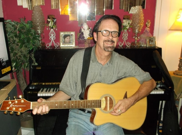 This is yours truly with my Kona acoustic/electric. This is an amazing guitar.
