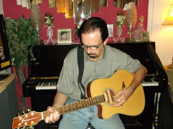 Another picture of me with my Kona acoustic/electric.
