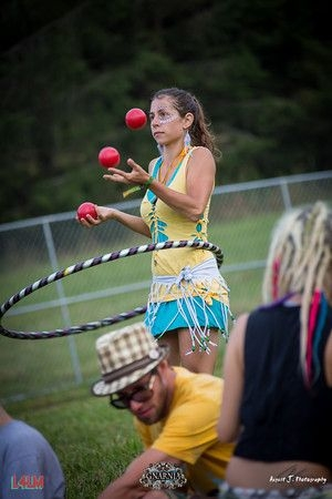 Simultaneously juggling and hula hooping at the same time
