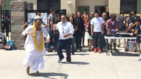 Dancing, singing and drumming at a high school function celebrating Multi-cultural day.