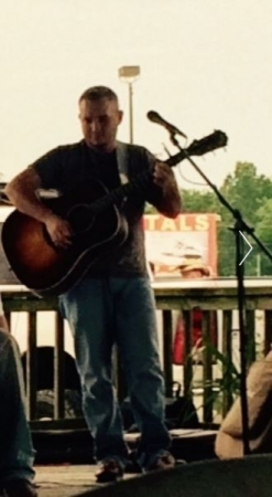 Live at a childhood cancer benefit at Papa's on the lake.