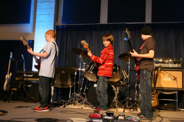 Cameron C., Ethan G., and Eli R. all performing Eye of the Tiger in one of our group performances.
