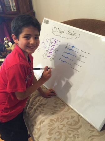 My sweet and bright 9 year old student mastering notes during our violin lesson! Only 2 months and he is a superstar!!!