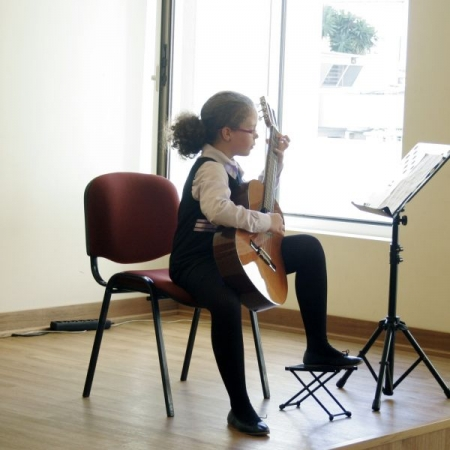 Young Guitar Student in Recital