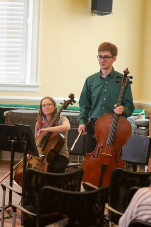 Alexander sharing program notes with the audience prior to a performance of Franz Schubert's String Quintet in C Major.