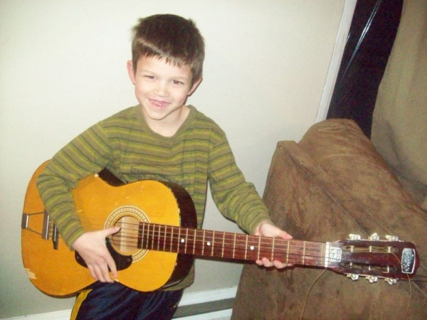One of my students learning how to play guitar!