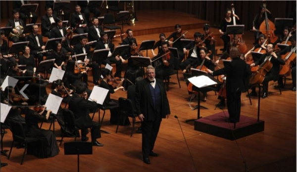 Gregory S., featured with the Chinese People's Liberation Army Symphony Orchestra in Beijing's National Theatre Concert Hall in 2013