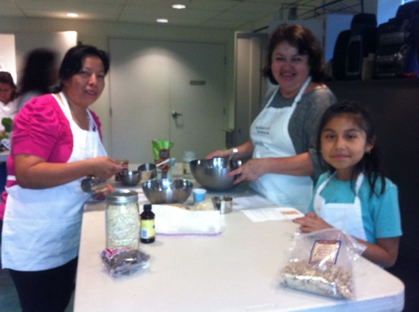 Teaching families about heart healthy cooking at WORKS USA.