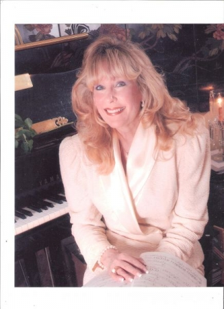Dr. Jeanne Today sitting at my piano  in my music studio in NW DC.