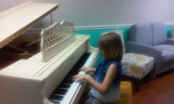 Here is Zoey testing out the piano before the recital.