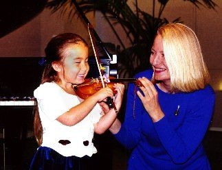 This little 4-year-old Twinkler has gone on to college with a violin under her arm.