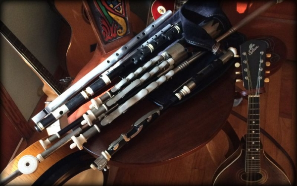 Some of the instruments I teach. Whistles, flute, pipes, guitar, mandolin, bodhran.