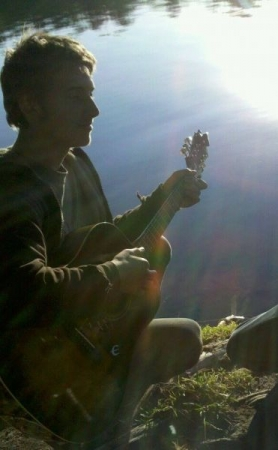 Me playing guitar by a pond in San Antonio, Texas.