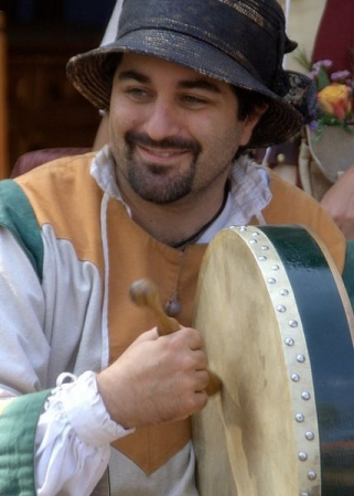 Playing a bodhran at Celtic festival