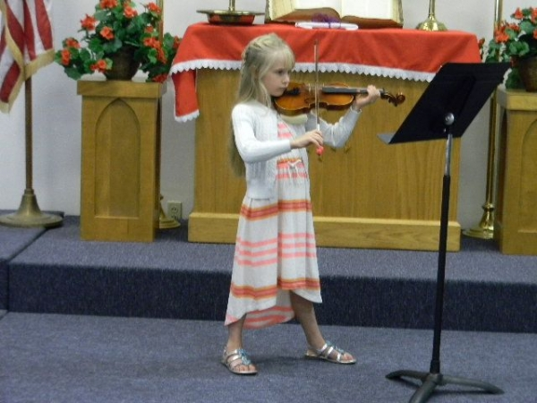 Young violinist at play