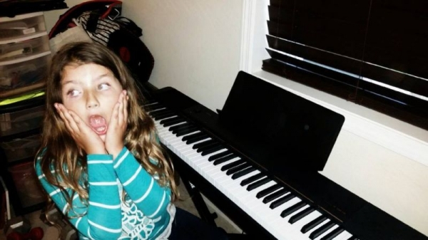 One of my students is very excited about her new piano!